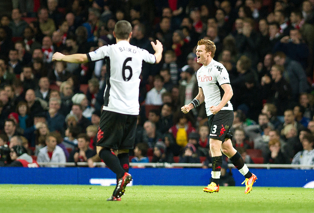 Fulham's John Arne Riise reacts with team mate Fulham's Chris Baird after scoring agains Arsenal, during  their English Premier League soccer match at the  Emirates stadium in London, Saturday, Nov. 26, 2011. (AP Photo/Bogdan Maran)