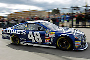 Jimmy Johnson heads to the track during practice for Sunday's NASCAR Sprint Cup race at Kansas Speedway in Kansas City, Kan., Saturday, Oct. 5, 2013. (AP Photo/Colin E. Braley)