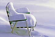 Oops. Should have brought in that lawn chair before the snow storm