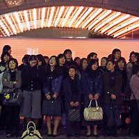 Asia, Japan, Tokyo. An orderly crowd of female fans waits outside a theater to watch the actor pass.