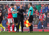Football - 2016 / 2017 Premier League - Arsenal vs. Manchester City.<br /> <br /> Pep Guardiola Manager of Manchester City confronts the referee Andre Marriner at the end of the game at The Emirates.<br /> <br /> COLORSPORT/DANIEL BEARHAM