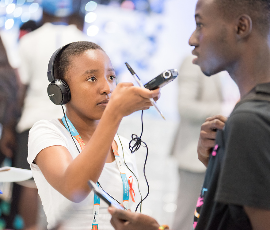 6 December 2017, Abidjan, Côte d'Ivoire: Radio journalist at work in the Global Village area at ICASA 2017. The 19th International Conference on AIDS and STIs in Africa (ICASA) 2017 gathers thousands of researchers, medical professionals, academics, activists and faith-based organizations from all over the world, all looking to overcome the HIV epidemic and eliminate AIDS as a public health threat.