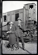 young adult man and woman standing by train coupe 1900s