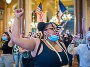 12 JUNE 2020 - DES MOINES, IOWA: Black Lives Matter supporters march through the Iowa capitol. About 75 activists from Black Lives Matter came to the Iowa State Capitol in Des Moines Friday to talk to Iowa Governor Kim Reynolds. They've been trying to meet with Gov. Reynolds all week. She made time for them Friday and met with 5 representatives of the organization without any media in the room. They wanted to talk to her about police violence against African-Americans and racial disparities in Iowa's justice system. While the 5 met with the Governor, the remaining activists picketed the hall in front of her office and chanted.    PHOTO BY JACK KURTZ