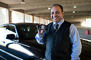 Sunny Singh, a driver for Uber, poses for a portrait in Dallas, Texas on October 22, 2013. Uber, an upscale car and driver company that has been welcomed in many major metropolitan areas, has faced a tougher-than-usual road in Texas, especially Dallas, where they continue to battle political and legal obstacles. (Cooper Neill / for The Texas Tribune)