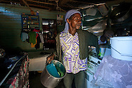 Haitian working on batey at Dominican Republic