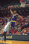 Feb 18, 2000; Orlando, Florida, USA; Kobe Bryant of the Los Angeles Lakers goes airborne for a dunk against Darrell Armstrong of the Orlando Magic at the TD Waterhouse Centre in Orlando, FL.  The Lakers beat the Magic 107-99.