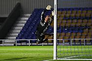 Arsenal goalkeeper Karl Hein (44) diving during the EFL Trophy match between AFC Wimbledon and U21 Arsenal at Plough Lane, London, United Kingdom on 8 December 2020.
