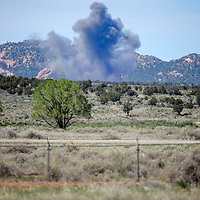 052015       Cable Hoover<br /> <br /> Smoke from a bomb disposal explosion rises over the horizon at the Fort Wingate Army Depot Wednesday.