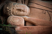 A sleeping Buddha statue is seen in a Buddhist temple in the Bamboo Sea National Park (Chinese:南山竹海) in Yibin, China, August 07, 2014.<br /> <br /> Confucianism, Taoism and Buddhism are the three major religions in China. Temples and statues witness their ancient roots all over the Chinese country.<br /> <br /> © Giorgio Perottino