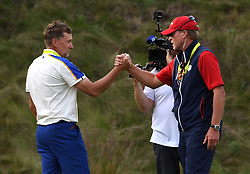 Team Europe's Ian Poulter (left) shake hands with Team USA captain Steve Stricker after Team USA win the Ryder Cup during day three of the 43rd Ryder Cup at Whistling Straits, Wisconsin. Picture date: Sunday September 26, 2021.