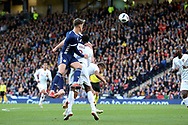 Scotland defender Jack Hendry (4) (Celtic)  gets up to heads the ball during the Friendly international match between Scotland and Portugal at Hampden Park, Glasgow, United Kingdom on 14 October 2018.