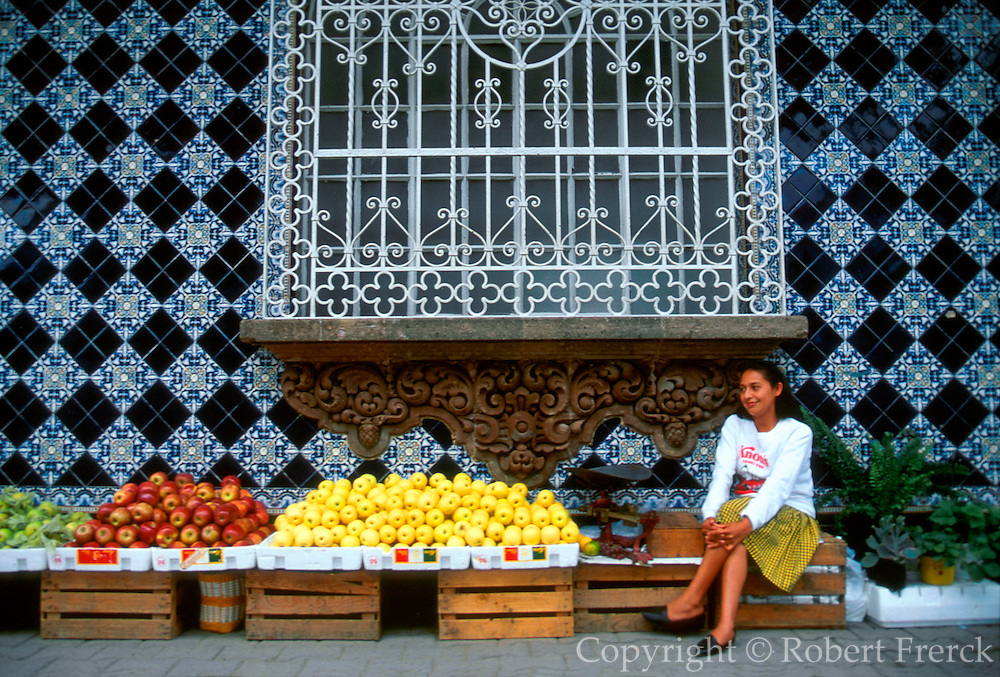 MEXICO, GULF COAST, VERACRUZ STATE Coatepec near Jalapa, colonial building with tile facade and street vendor selling produce