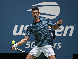 August 28, 2018 - Flushing Meadows, New York, U.S - Novak Djokovic during his match against Marton Fucsovics on Day 2 of the 2018 US Open at USTA Billie Jean King National Tennis Center on Tuesday August 28, 2018 in the Flushing neighborhood of the Queens borough of New York City. Djokovic defeats Fucsovics, 6-3, 3-6, 6-4, 6-0. (Credit Image: © Prensa Internacional via ZUMA Wire)