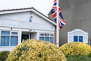 Two days after the killing of the Conservative member of parliament for Southend West, Sir David Amess MP, a Union Jack is at half-mast outside his Southend West Conservative Association constituency office on Leigh Road is a short distance from the scene of his murder at Belfairs Methodist Church in Leigh-on-Sea, on 17th October 2021, in Leigh-on-Sea, Southend , Essex, England. Amess was conducting his weekly constituency surgery when attacked with a knife by Ali Harbi Ali.