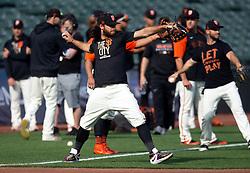 Oct 7, 2021; San Francisco, CA, USA; San Francisco Giants infielder Brandon Crawford, center, loosens up during NLDS workouts. Mandatory Credit: D. Ross Cameron-USA TODAY Sports