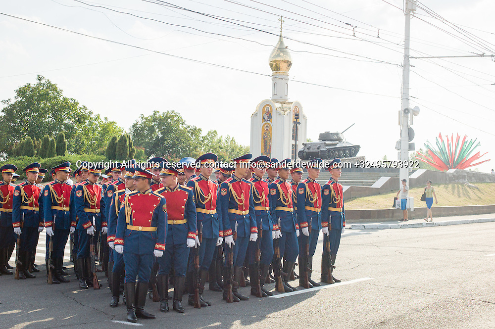 20150831 Moldova, Transnistria,Pridnestrovian Moldavian Republic (PMR) Tiraspol. Rehersal for the big parade, in the 25th  Transnistrian independance day when  they had a war separating from Moldova.Elite corps in red and blue standing in front of the tank and a russion orthodox church ,symbols of the nation.