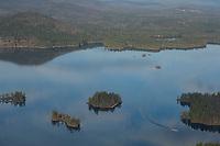 Lone boat on Squam Lake New Hampshire.  ©2012 Karen Bobotas Photographer