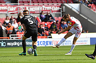 Doncaster Rovers forward Alfie May (19) takes a long range shot at goal  during the EFL Sky Bet League 1 match between Doncaster Rovers and Portsmouth at the Keepmoat Stadium, Doncaster, England on 25 August 2018.Photo by Ian Lyall.