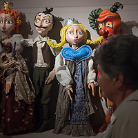 Visitor watches puppets seen on display at a puppet exhibition in the Petofi Literature Museum in Budapest, Hungary on Sept. 6, 2018. ATTILA VOLGYI
