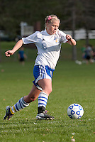 Senior Chelsea Crockett of Gilford High School varsity soccer scores her 100th career goal during Tuesday's matchup at Gilford Field.  (Karen Bobotas/for the Laconia Daily Sun)
