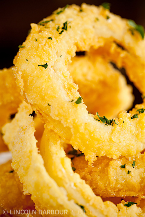 A close up of delicious looking onion rings ready to be eaten.