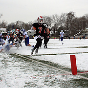 Alexander LaPolice, New Canaan, goes in for a touchdown during the New Canaan Rams Vs Darien Blue Wave, CIAC Football Championship Class L Final at Boyle Stadium, Stamford. The New Canaan Rams won the match in snowy conditions 44-12. Stamford,  Connecticut, USA. 14th December 2013. Photo Tim Clayton