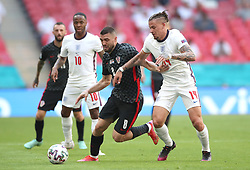 Croatia's Mateo Kovacic (left) and England's Kalvin Phillips battle for the ball during the UEFA Euro 2020 Group D match at Wembley Stadium, London. Picture date: Sunday June 13, 2021.