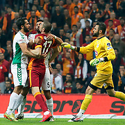 Galatasaray's Burak Yilmaz (C) and TorkuKonyaspor's Ali Turan (L) during their Turkish Super League soccer match Galatasaray between TorkuKonyaspor at the AliSamiYen Spor Kompleksi TT Arena at Seyrantepe in Istanbul Turkey on Friday, 08 May 2015. Photo by Kurtulus YILMAZ/TURKPIX