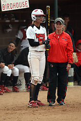 06 April 2013:  Kolby Hoffman and Melinda Fischer have a pre-bat chat during an NCAA Division 1 Missouri Valley Conference (MVC) women's softball game between the Drake Bulldogs and the Illinois State Redbirds on Marian Kneer Field in Normal IL