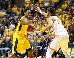 Jan 20, 2018; Morgantown, WV, USA; West Virginia Mountaineers guard Daxter Miles Jr. (4) calls out a play during the second half against the Texas Longhorns at WVU Coliseum. Mandatory Credit: Ben Queen-USA TODAY Sports