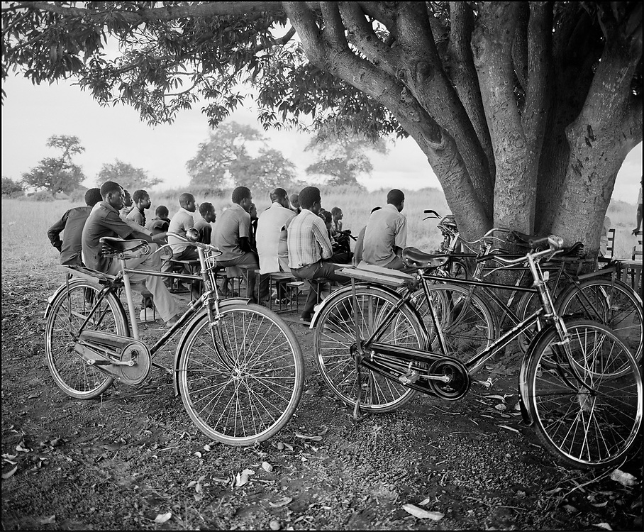 Karamajong men being instructed by a LWF developmen team Karamoja-  Uganda 1980