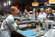 Photograph of celebrity chef Cat Cora holds a cooking demonstration at Rouses Markets in New Orleans, LA.