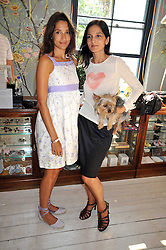 Left to right, ASTRID MUNOZ and YASMIN MILLS at the 10th anniversary party of the store Caramel, Ledbury Road, London W11.  The party was held in association with the Naked Heart Foundation - a charity set up by model Natalia Vodianova.