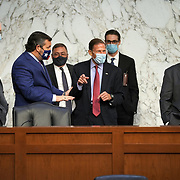 Sen. Richard Blumenthal (D-Conn.) jokes with Sen. Ted Cruz (R-Texas), left, about reclaiming his time after the microphone system in the hearing room failed during the third day of the Senate Judiciary Committee confirmation hearing for President Donald Trump's Supreme Court nominee Judge Amy Coney Barrett on Wednesday, October 14, 2020.