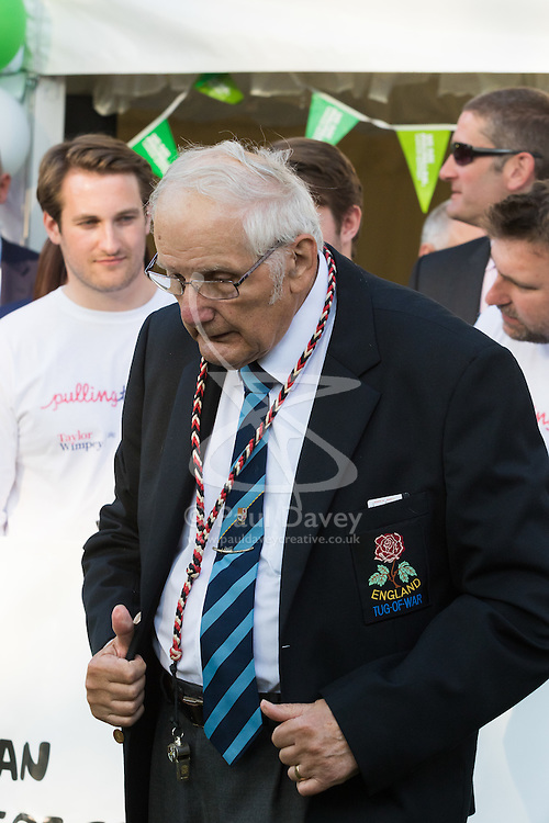 Westminster, London, June 6th 2016.The judge prepares for another match as teams from uk industry as well as the House of Commons and the House of Lords compete in the annual McMillan Cancer Charity tug o' war.
