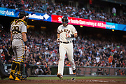 San Francisco Giants catcher Buster Posey (28) scores a run against the Pittsburgh Pirates at AT&T Park in San Francisco, California, on July 25, 2017. (Stan Olszewski/Special to S.F. Examiner)