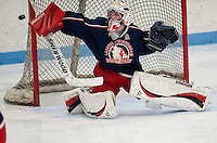Laconia-Winnisquam goalie Cody Yale makes a save during Saturday night's NHIAA Division III matchup with Moultonboro-Interlakes at the Laconia Ice Arena.  (Karen Bobotas/for the Laconia Daily Sun)