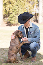 cowboy and his dog enjoying time together