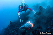diver Bud Turpin observes erupting pillow lava at underwater eruption of Kilauea Volcano, Hawaii Island ( the Big Island ), Hawaii, U.S.A. ( Central Pacific Ocean ) MR 381