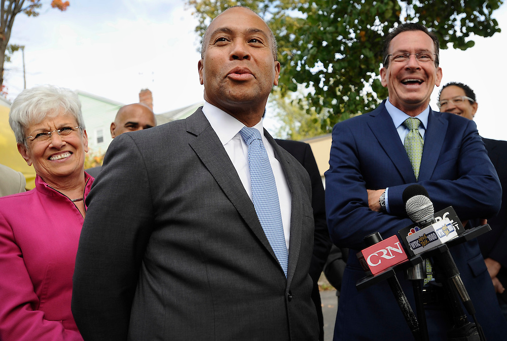 Massachusetts Gov. Deval Patrick, center speaks at a campaign stop as Lt. Gov. Nancy Wyman, left, and Gov. Dannel P. Malloy, right, smile, Friday, Oct. 10, 2014, in Hartford, Conn. Patrick was in Connecticut to campaign for Malloy on Oct. 10 to highlight the governor's efforts to increase Connecticut's minimum wage to $10.10 an hour. (AP Photo/Jessica Hill)