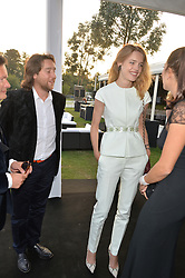 Right, NATALIA VODIANOVA at the Chovgan Twilight Polo Gala in association with the PNN Group held at Ham Polo Club, Petersham Close, Richmond, Surrey on 10th September 2014.
