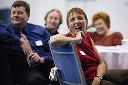 An amused audience at an NHS Training event on staff development,