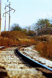 Railroad tracks snake and curve across the landscape.