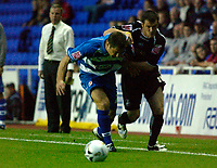 Photo: Daniel Hambury.<br /> Reading v Swansea. Carling Cup.<br /> 23/08/2005.<br /> Reading's John Oster and Swansea's Kevin McLeod battle for the ball.