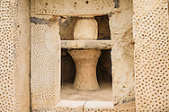 Decoratively drilled porthole entrance through a stone slab into one of the many apses at Mnajdra Temples