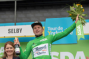 Jesper Asselman of Roompot - Charles winner of stage 1 of the 2019 Tour de Yorkshire on podium wearing sprinters classification green jersey for stage winner presentation during the first stage of the Tour de Yorkshire from Doncaster to Selby, Doncaster, United Kingdom on 2 May 2019.