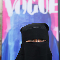 """VENICE, ITALY - JUNE 01:  A model poses in front of Flavio Lucchini's work """"poster/vogue"""" part of the exhibition """"What Women Want (?)"""" on June 1, 2011 in Venice, Italy. The exhibition addresses the controversiat theme of the burqa"""