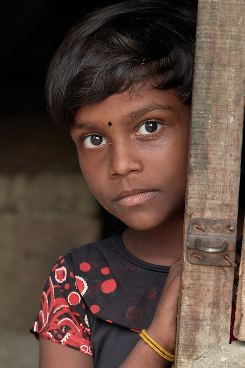 A girl in Parantan, Kilinochchi, Sri Lanka. Her mother participates in a church-sponsored women's group, many of whose members are widows whose husbands were killed during the country's brutal civil war.