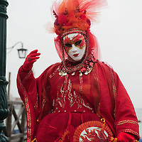 VENICE, ITALY - FEBRUARY 11:  A woman wearing a Carnival costume poses for pictures in St. Mark's Square on February 11, 2012 in Venice, Italy.The annual festival, which lasts nearly three weeks, will see the streets and canals of Venice filled with people wearing highly-decorative and imaginative carnival costumes and masks.